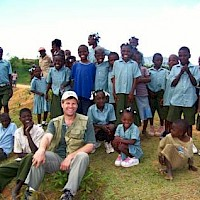 President & CEO, David Cole with school children at the Danty camp, northern Haiti.